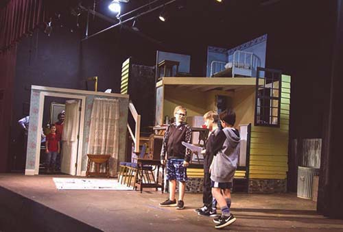 Preston Leathers and Tony Greiner wait offstage as L-R Grayson Ludington, Silas Thomas and Dylan Lo work on a scene.