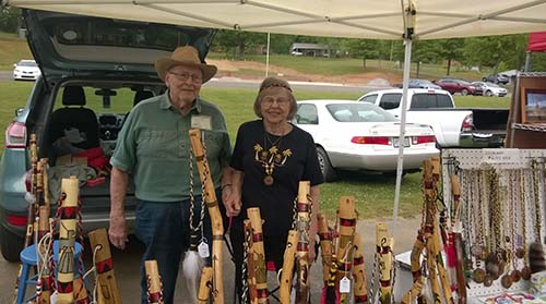 Walking sticks carved by Tom with Donna at his side