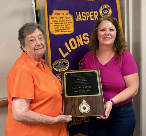 Lion Eloise Lindsey presenting the Lion of the Year Award to Lion Pauline Maturo.