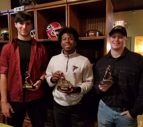 L-R:   Junior Ben Harrison, Senior JaRon Davie and Senior Harrison Hardage received 2018 NHFA All Star Team award given to stand out players.