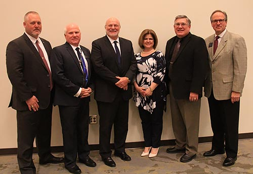 State of the Community with (L-R) Sheriff Donnie Craig, Superintendent Dr. Carlton Wilson, Jasper Mayor John Weaver, Pickens Chamber Director Amberle Godfrey, Commissioner Chairman Rob Jones, and Tim Norton, Vice President for Advancement & Marketing